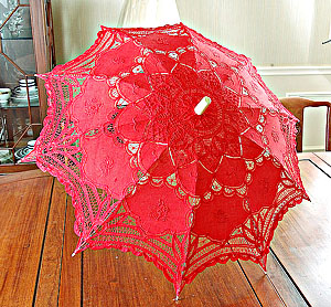 red colored lace parasol.