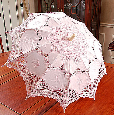 pink colored lace parasol