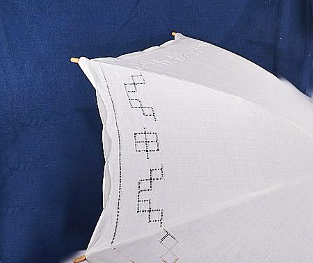 white cotton parasol